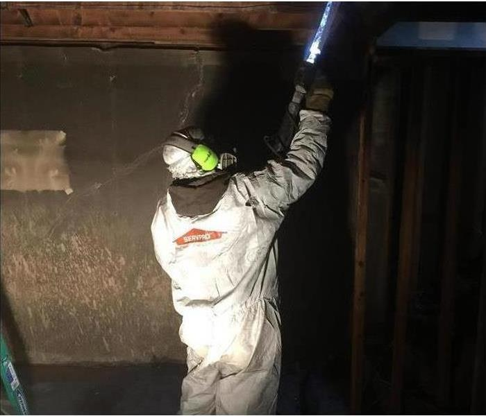 One of our service professionals using a dry ice blasting machine in his Personal Protective Equipment. (PPE)