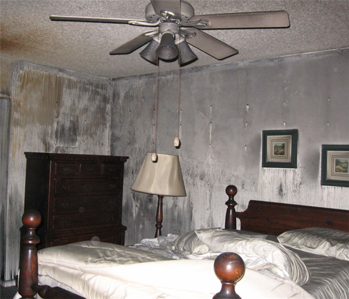 A bedroom that has been on fire.