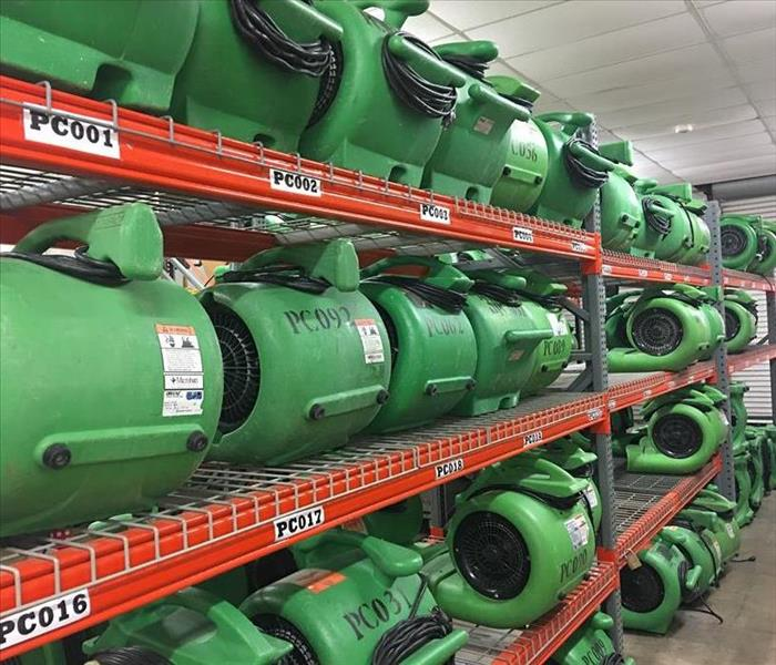 Servpro drying fans in a storage facility.